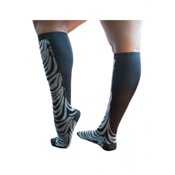 Xpandasox® Womens knee high length socks in a white and black zebra print with Xpandapanel calf area in black.